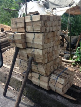 dakbedekking met houten leii'tjes